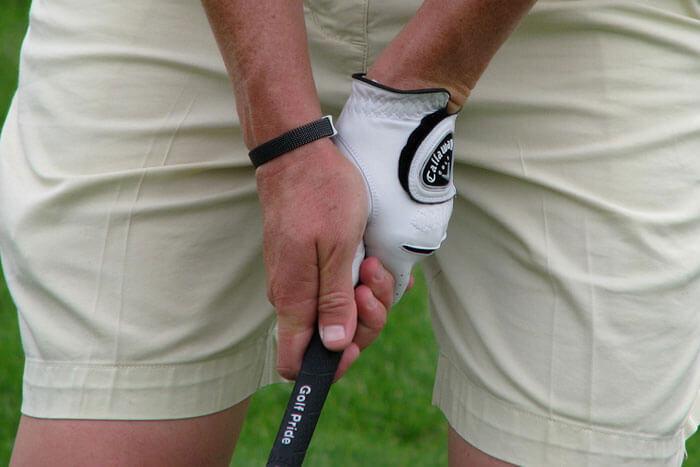 holding a golf club