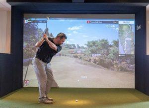 playing golf simulator